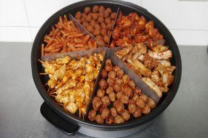 Heerlijke warme hapjes in een handomdraai op tafel. Deze pan bevat ongeveer 100 hapjes.